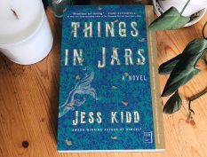 Things in Jars book beside a candle