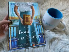 Book of Lost Names with mug