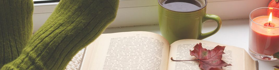 Cozy reading with a fall leaf and coffee