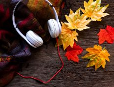 Headphones laying on fall leaves