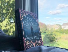 The Lost Queen book by window