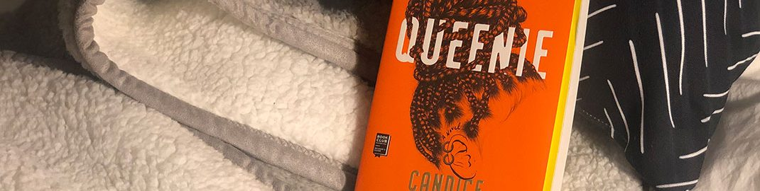 Queenie book on a blanket