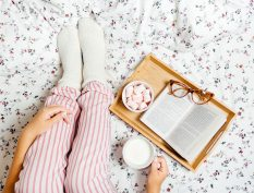 Reader in bed with pjs