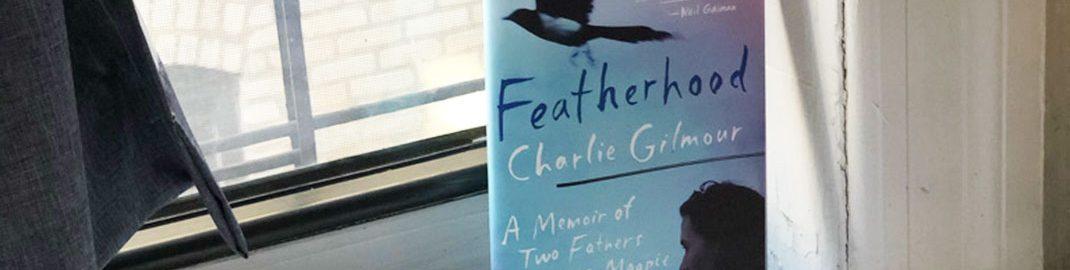 Featherhood book resting by a window