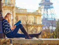 Woman reading by the Eiffel Tower