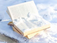 Pile of snow on an open book