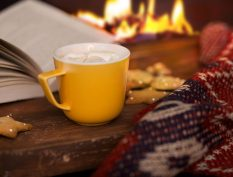 Reading by the fire with hot chocolate