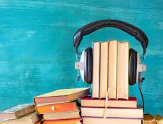 Books wearing headphones