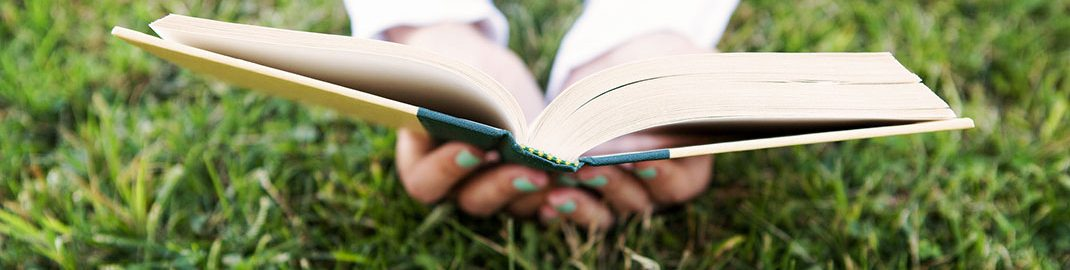 Reading a new book in the grass