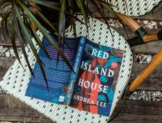 Red Island House book with a plant