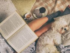 Reading in bed with puppy