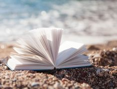 Open book by the ocean