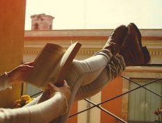 Reading on a balcony