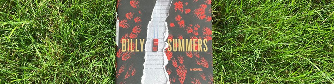 Billy Summers by Stephen King laying in the grass