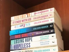 Colleen Hoover books stacked on a shelf